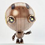 retro child robot raising arm