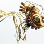 robotic organ wooden heart with metal parts wired