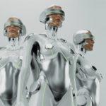 Three futuristic robot women in VR. Silver sexy cyborgs trio