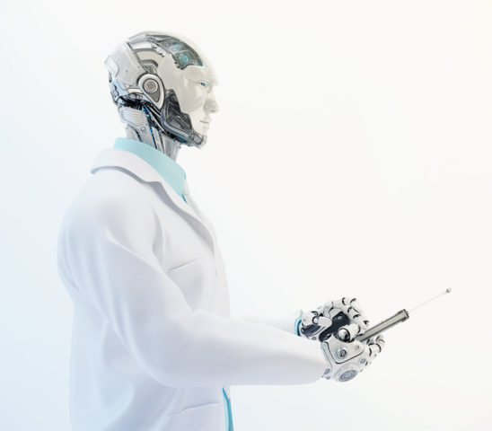 Robot doctor in medical gown holding tablet in profile