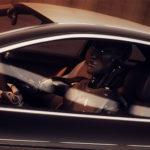 Futuristic robot driving car 3d render